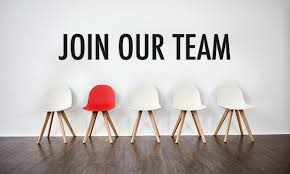 a line of white chairs with one red chair, above them on the wall it says join our team